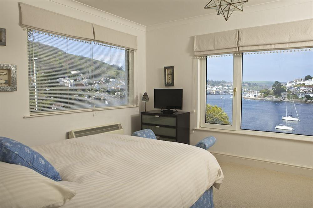 Double bedroom with panoramic views along the River Dart towards the Naval College at 1 Galions Quay in , Dartmouth