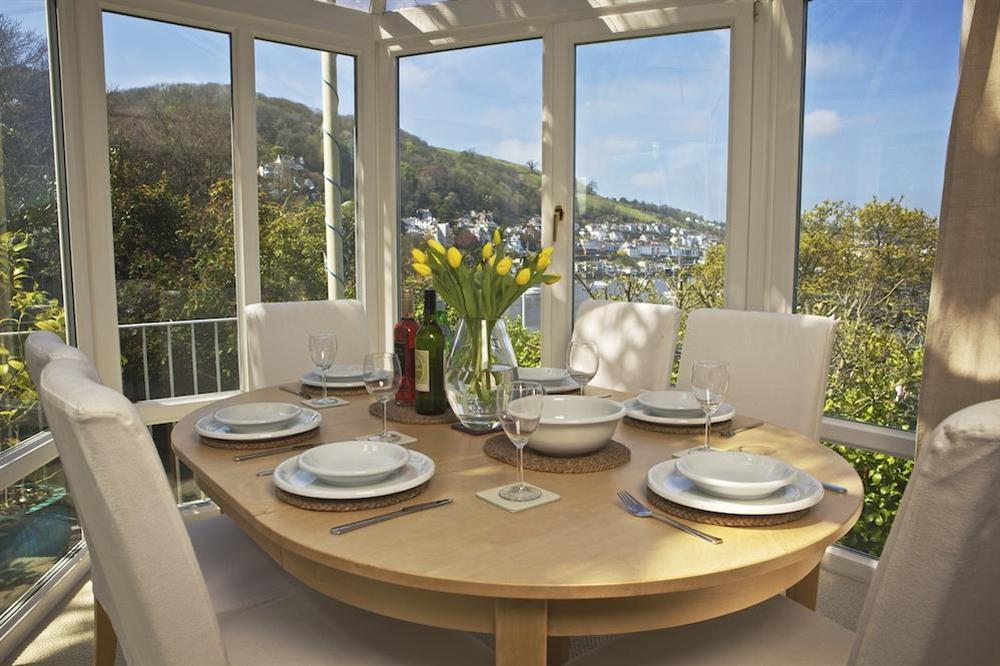 The dining room/conservatory with river views at 1 Galions Quay in , Dartmouth