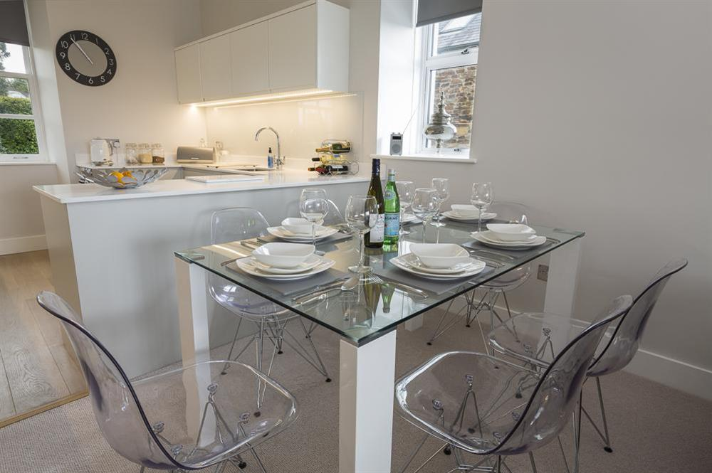 Beautiful glass topped dining table seating six comfortably at 1 The Manor House, Hillfield Village in , Hillfield, Dartmouth