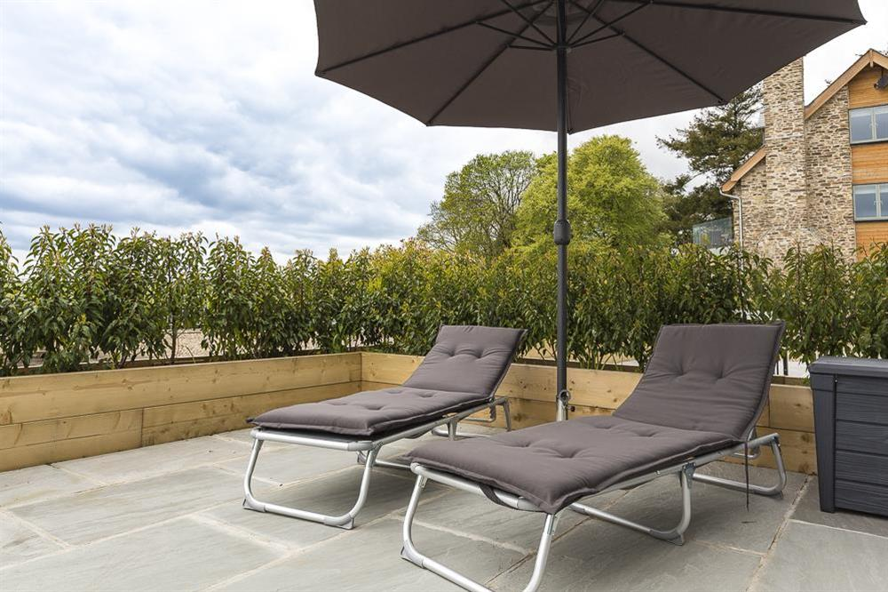 Delightful terrace with sun loungers at 1 The Manor House, Hillfield Village in , Hillfield, Dartmouth