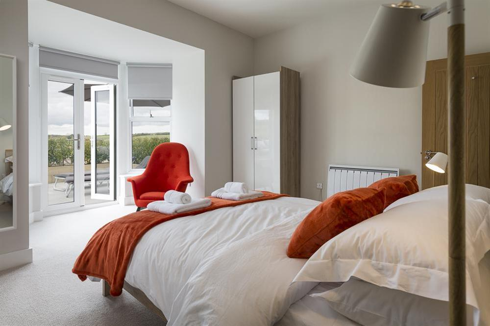 En suite master bedroom with doors to terrace at 1 The Manor House, Hillfield Village in , Hillfield, Dartmouth