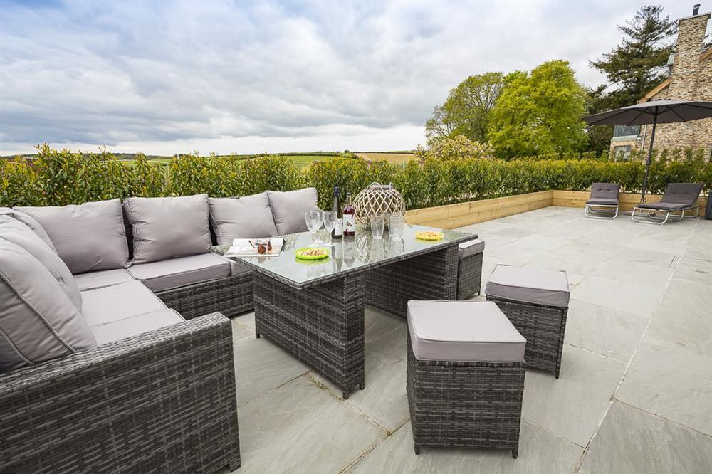 Large terrace area with garden furniture at 1 The Manor House, Hillfield Village in , Hillfield, Dartmouth