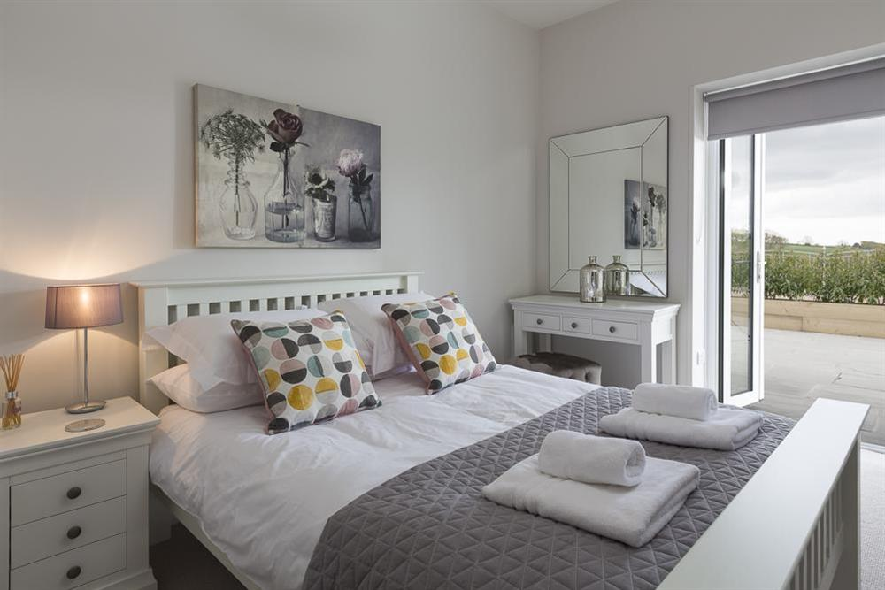 Lovely double bedroom with doors to terrace at 1 The Manor House, Hillfield Village in , Hillfield, Dartmouth