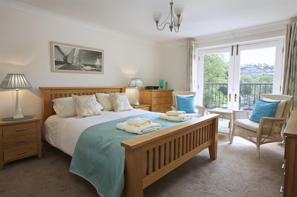 Master bedroom with King-size bed at 10 Dartmouth House in Mayors Avenue, Dartmouth