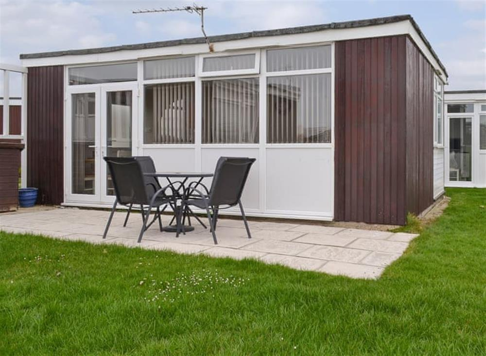 Contemporary holiday home with paved patio area at 14 Toledo in Selsey, near Chichester, West Sussex