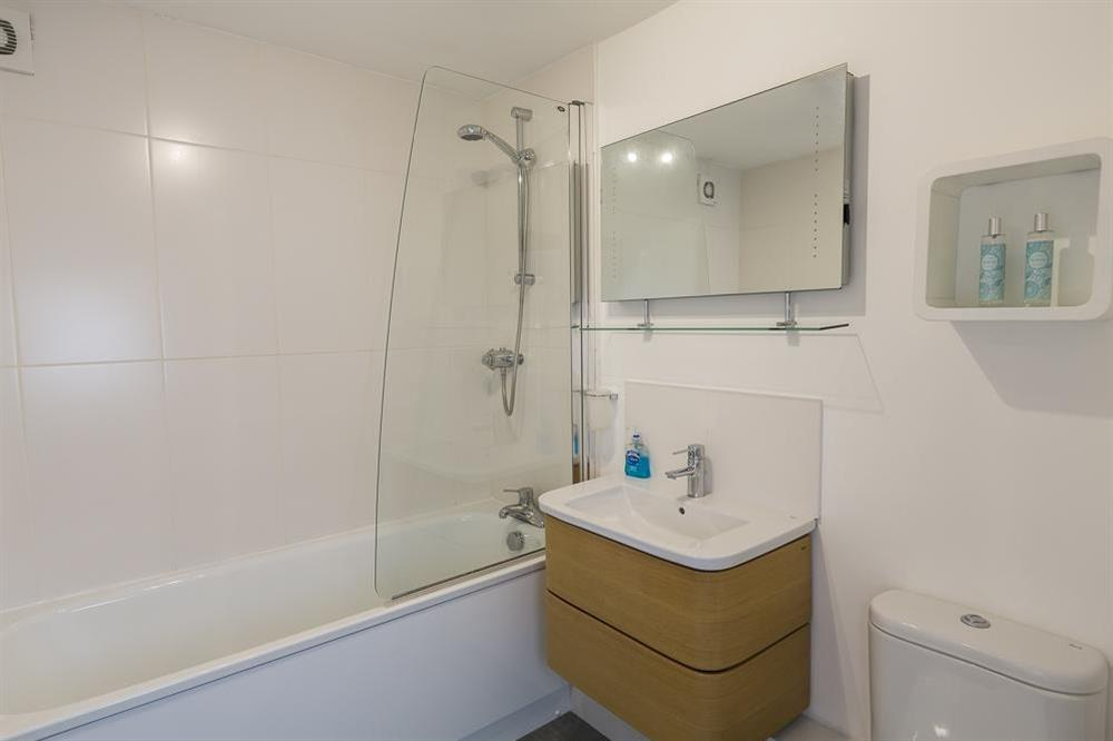 First floor bathroom with a bath, shower (over), w.c. and wash-hand basin at 16 Dartmouth House in , Dartmouth