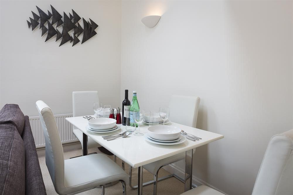 Tastefully furnished with dining table and chairs at 16 Dartmouth House in , Dartmouth