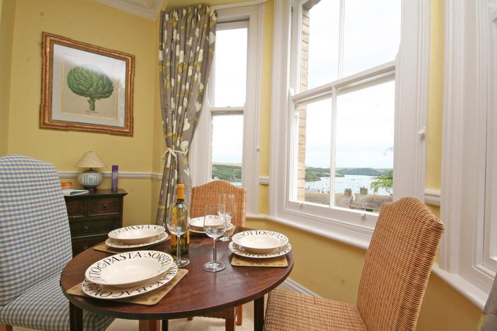Dining area with views over rooftops to the estuary at 1c Harbour View in Devon Road, Salcombe