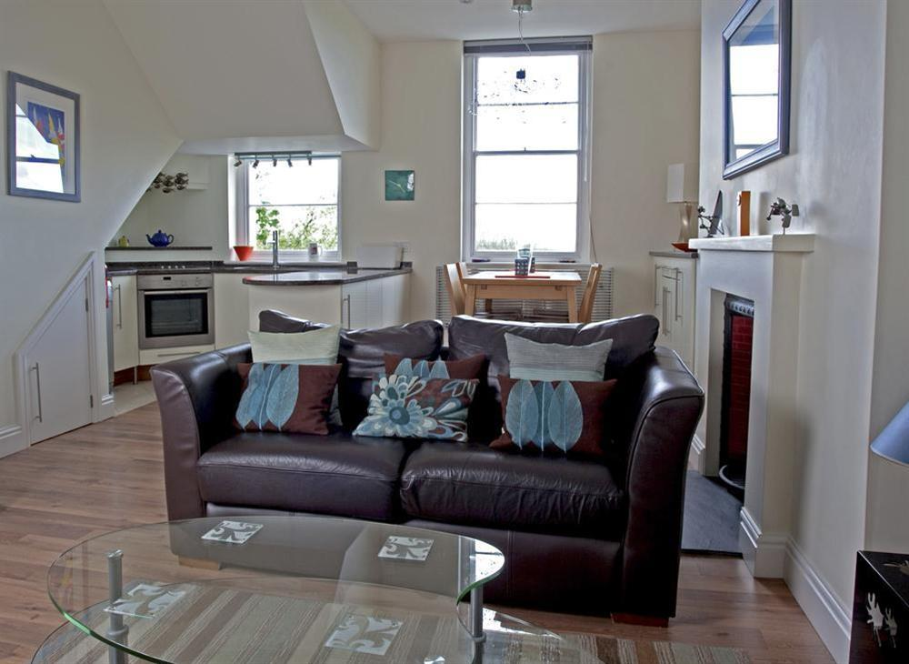 A bright, comfortably furnished open-plan room with lovely views at 2 Albany House in Allenhayes Road, Salcombe