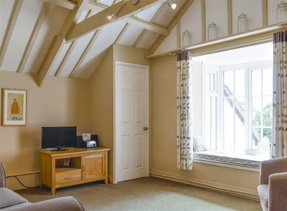 Characterful living room with exposed wood beams at 2 Albury Cottage in Charmouth, Dorset