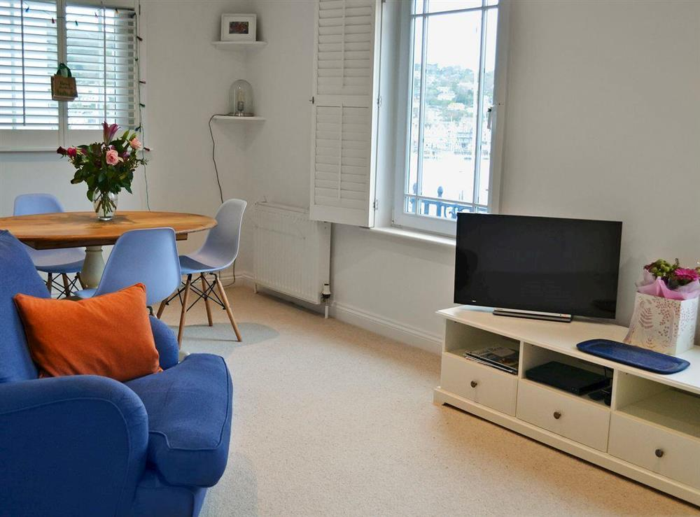 Bright and airy living/dining room at 2 College View Lower Apartment in Kingswear, Devon