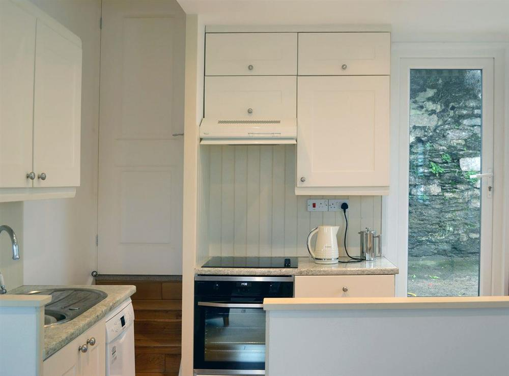Well equipped kitchen area at 2 College View Lower Apartment in Kingswear, Devon