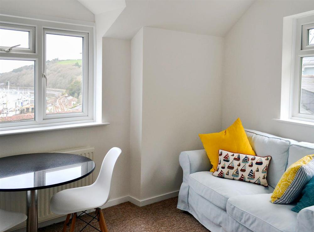 Sitting area with lovely views over the river at 2 College View Upper Apartment in Kingswear, Devon