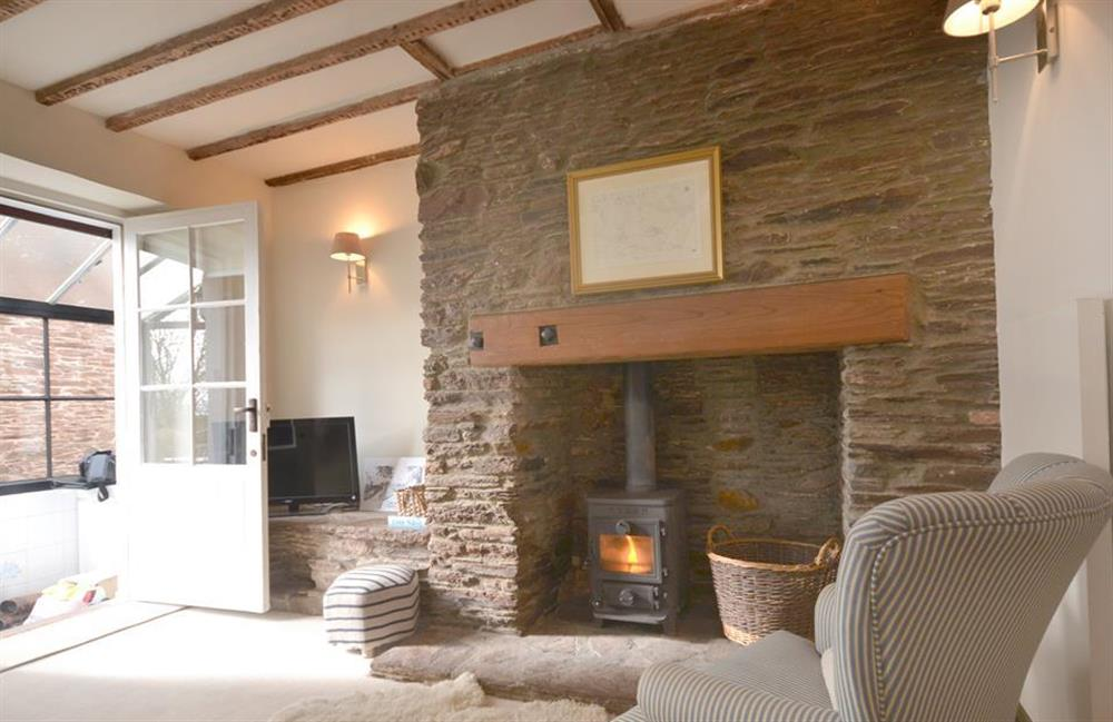 The cosy lounge with logburner at 2 South View Terrace, Slapton