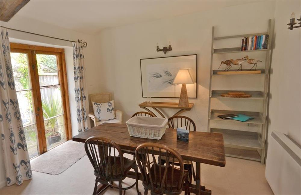 The dining room with patio doors to the rear courtyard at 2 Vale Cottage, Slapton