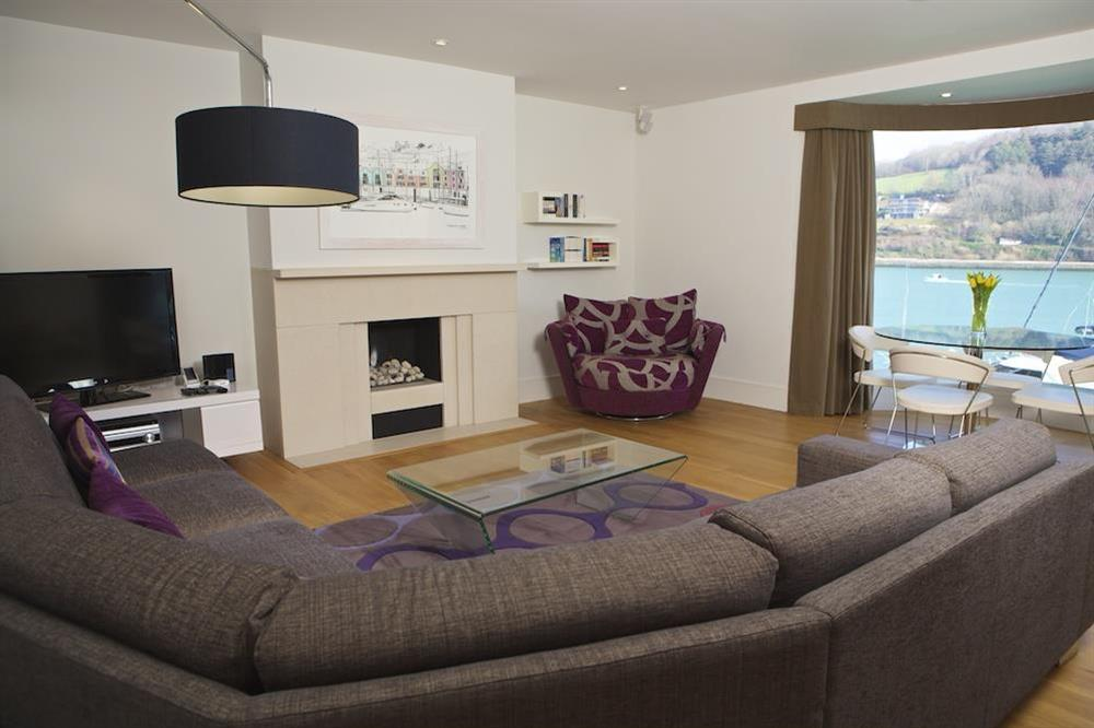 Large lounge with dining area and views over the River Dart at 21 Dart Marina in Sandquay Road, Dartmouth