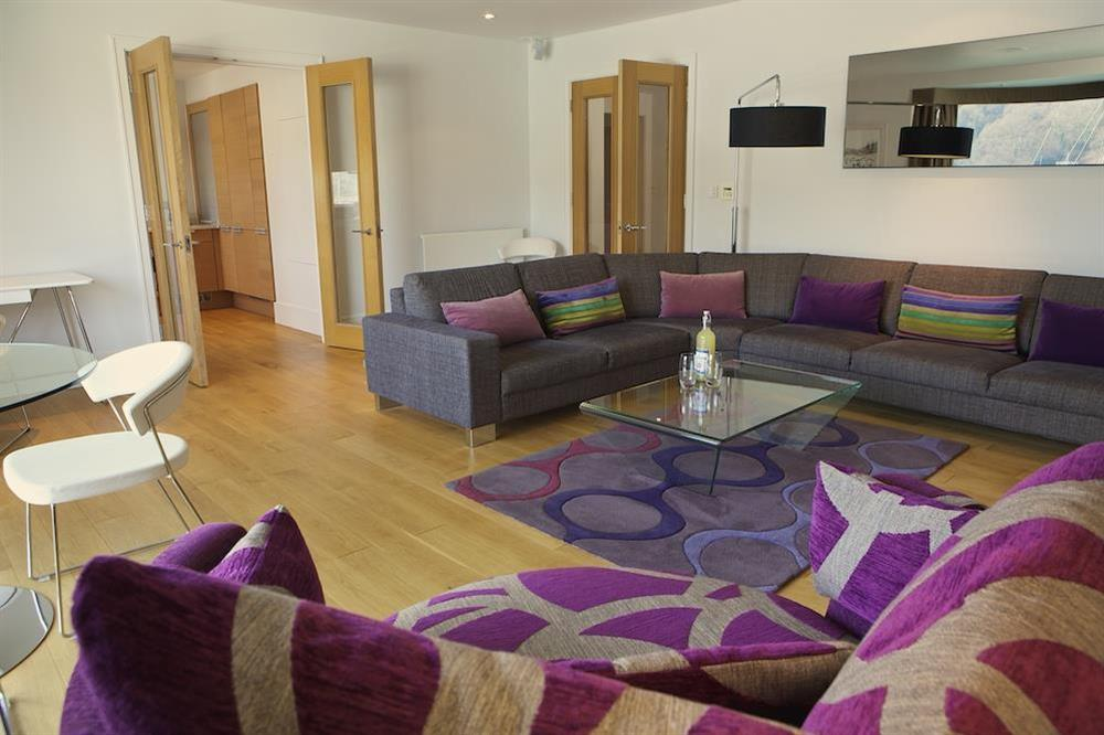 Large lounge with glass dining table at 21 Dart Marina in Sandquay Road, Dartmouth