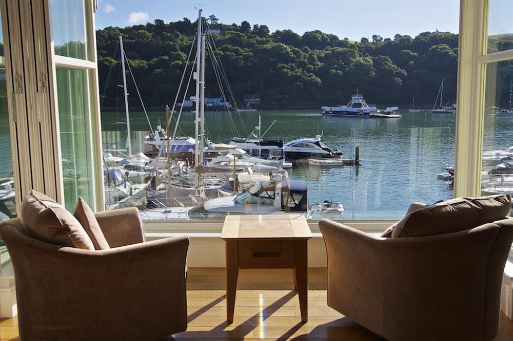 Bi-folding windows open to offer panoramic river views at 22 Dart Marina in , Dartmouth