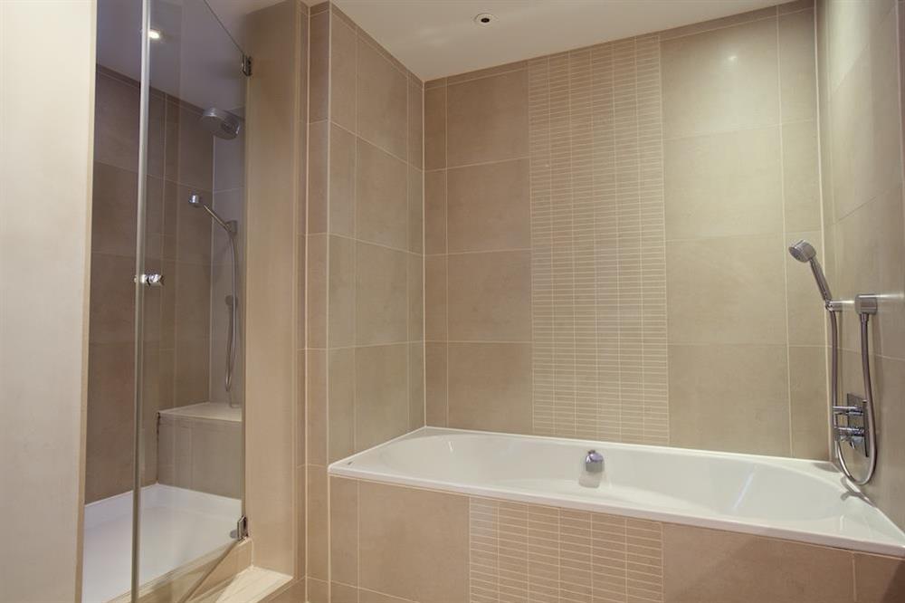 Fully-tiled en suite bathroom at 22 Dart Marina in , Dartmouth