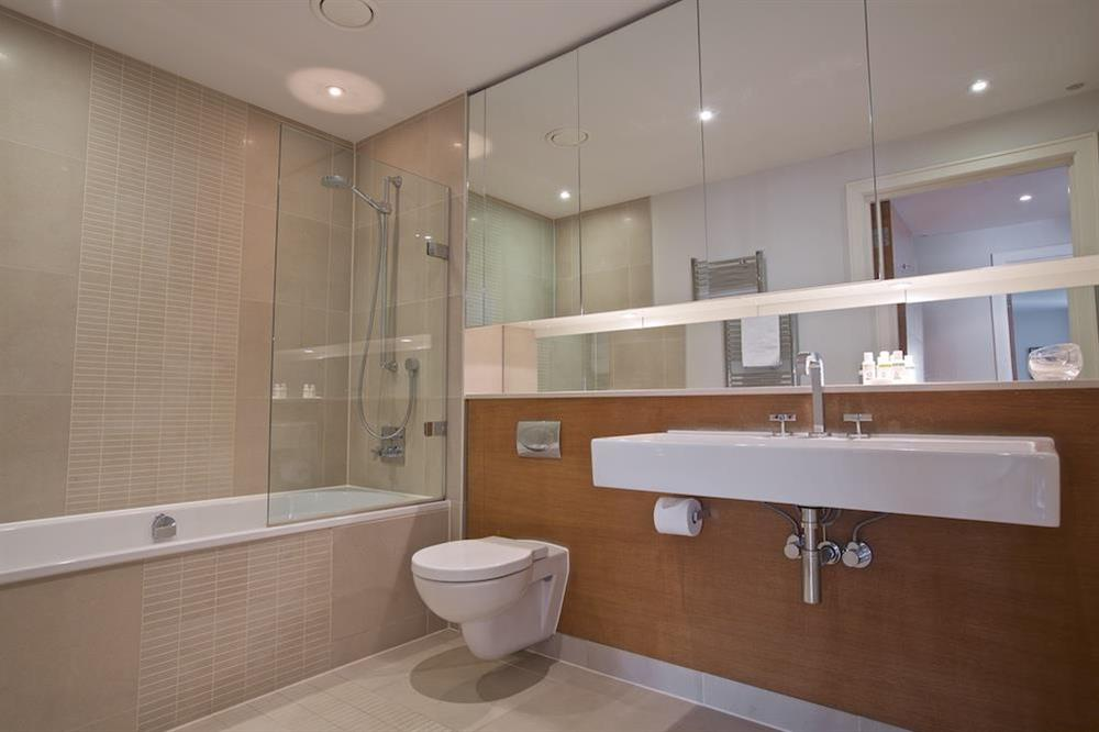Fully-tiled family bathroom at 22 Dart Marina in , Dartmouth