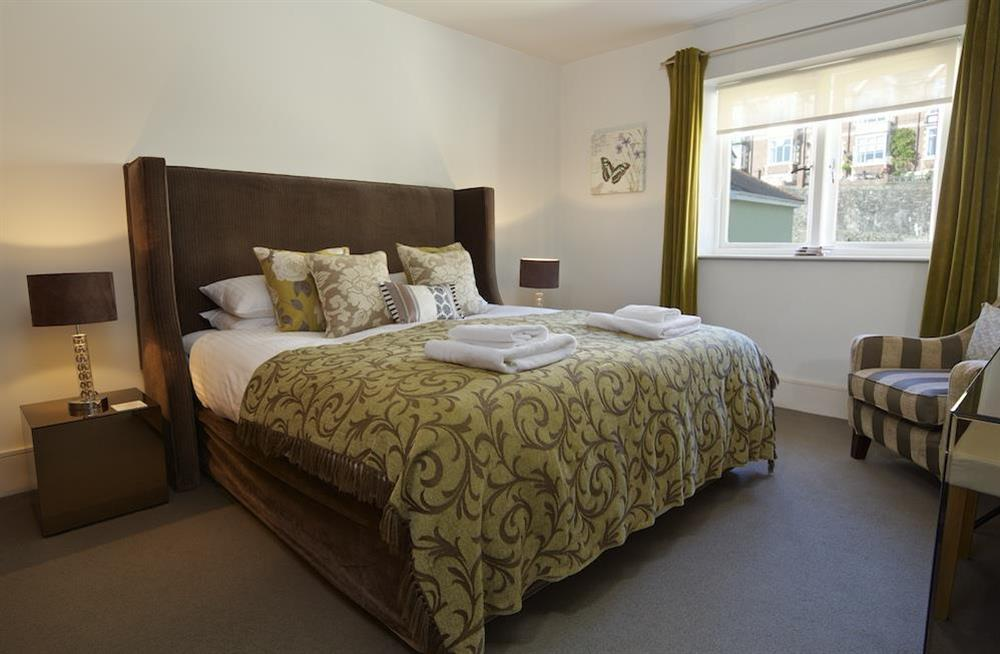 Master bedroom with King-size bed and en suite bathroom at 22 Dart Marina in , Dartmouth