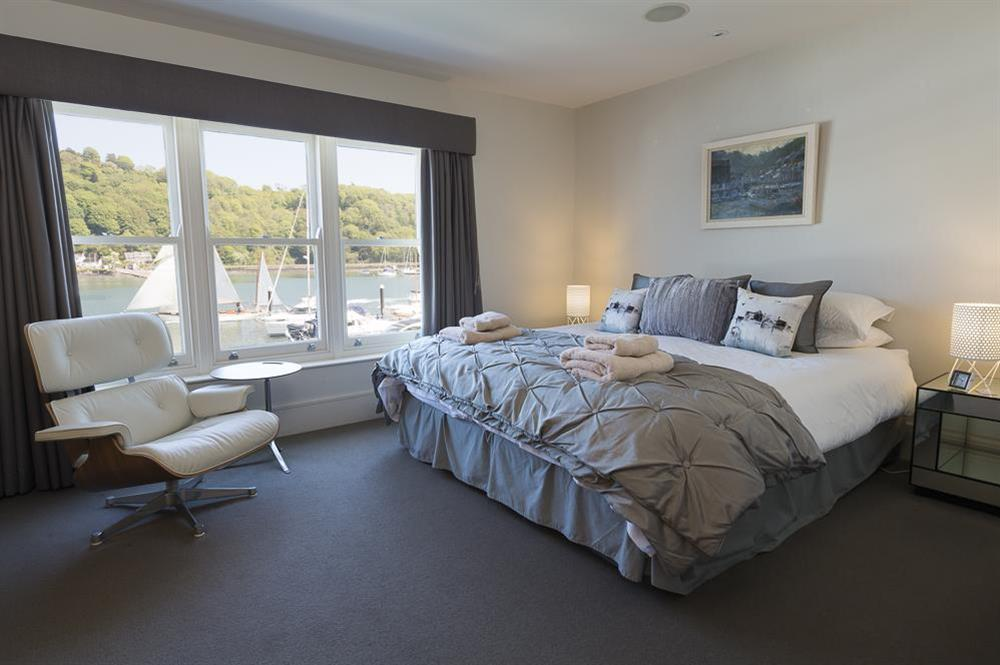 En suite master bedroom with river views and super-King size bed at 28 Dart Marina in , Dart Marina