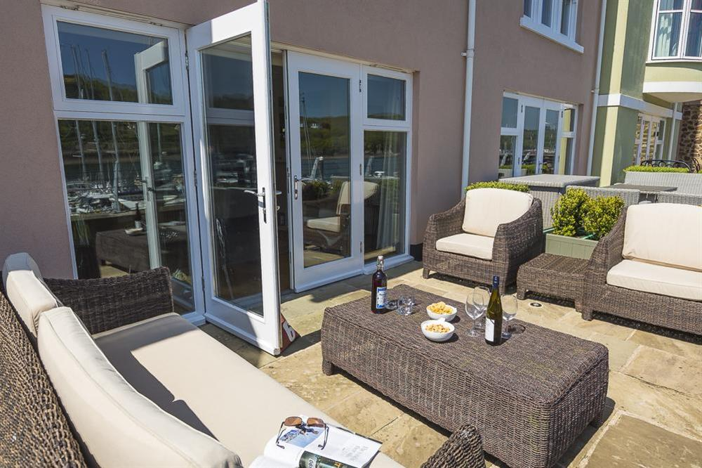 Large French doors lead out to the furnished terrace at 28 Dart Marina in , Dart Marina