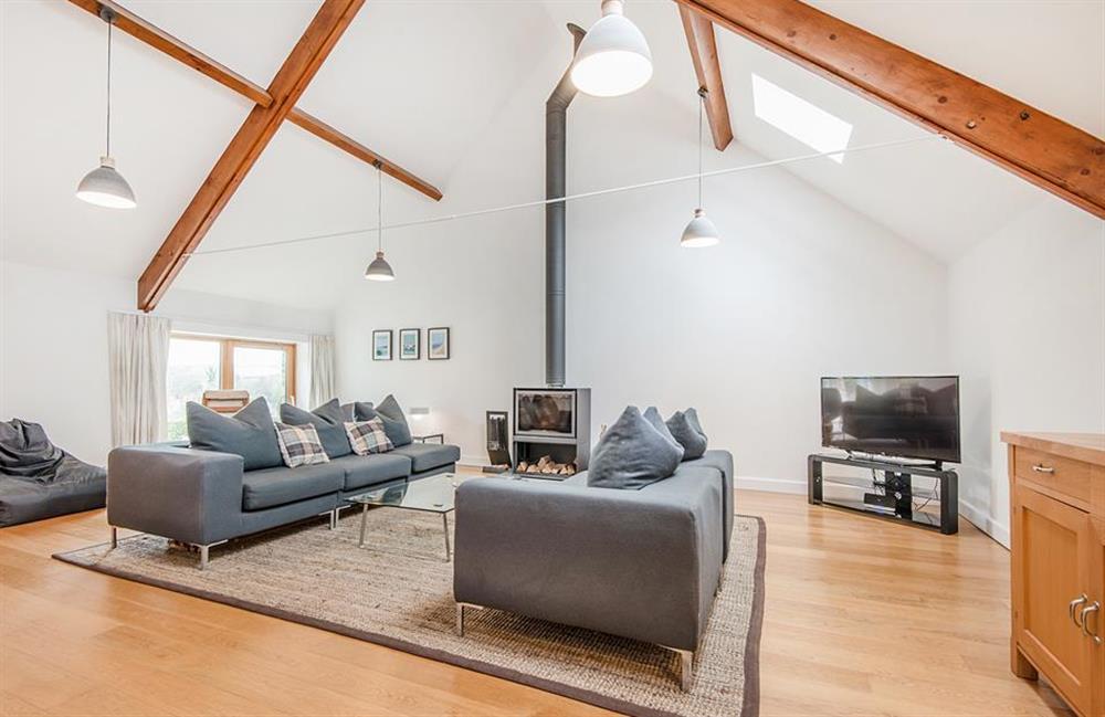 The open plan lounge wth log burner at 3 Dufour, East Allington