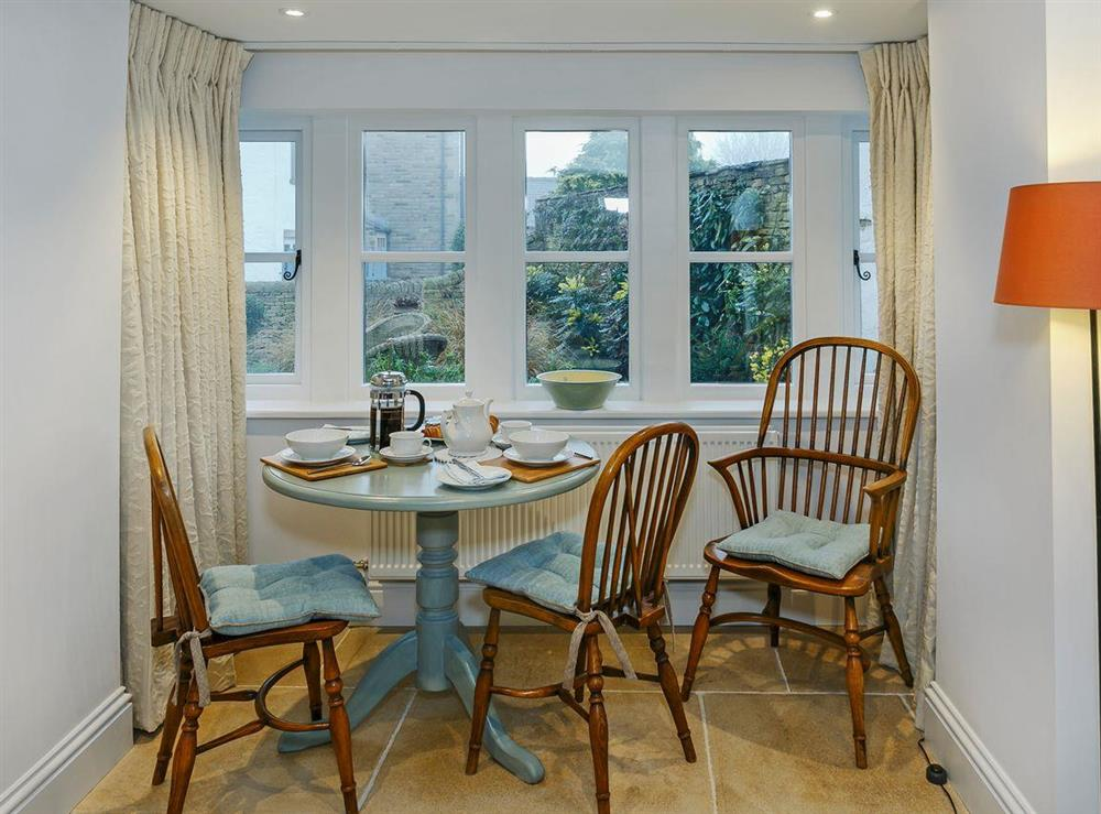 Charming dining area at 3 Healey Cottage in Shelley, near Huddersfield, West Yorkshire