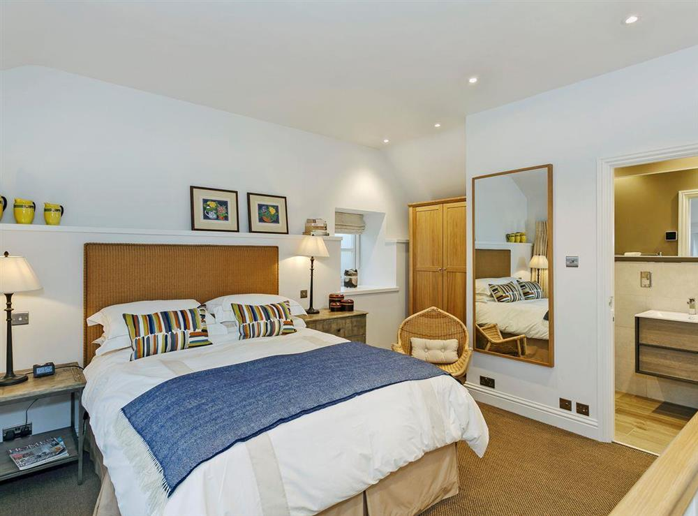 Elegantly decorated double bedroom with kingsize bed at 3 Healey Cottage in Shelley, near Huddersfield, West Yorkshire