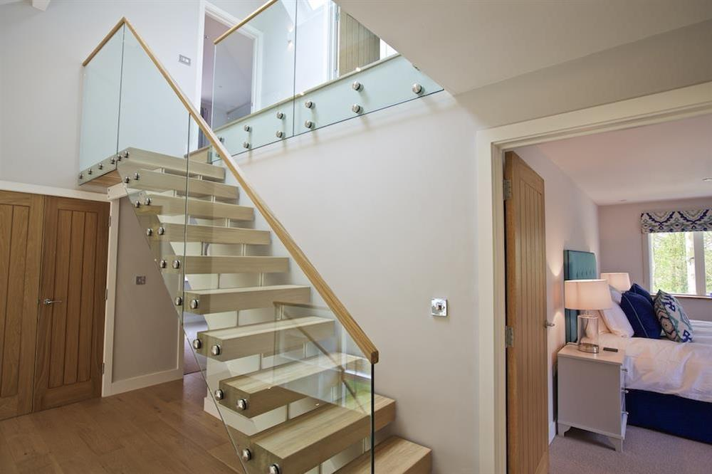 Access to the second floor via an oak and glass staircase (photo 2) at 3 The Drive in , Hillfield, Dartmouth