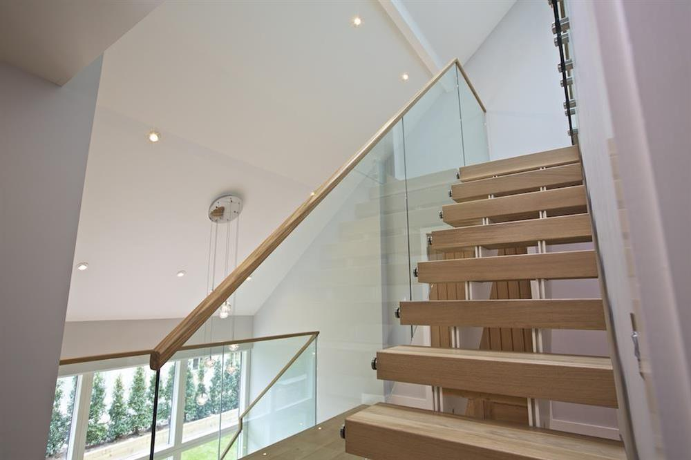 Access to the second floor via an oak and glass staircase (photo 3) at 3 The Drive in , Hillfield, Dartmouth