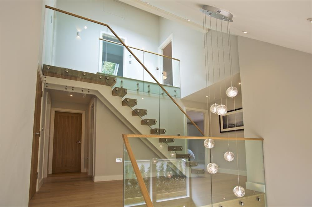 Access to the second floor via an oak and glass staircase at 3 The Drive in , Hillfield, Dartmouth