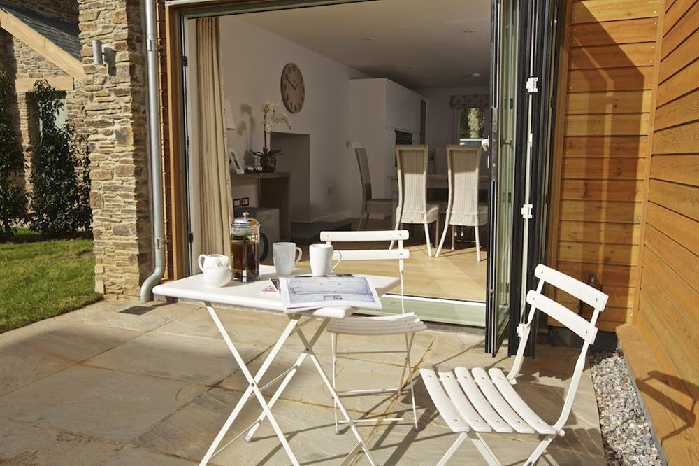 Bi-folding glass doors open to the terrace and garden at 3 The Drive in , Hillfield, Dartmouth