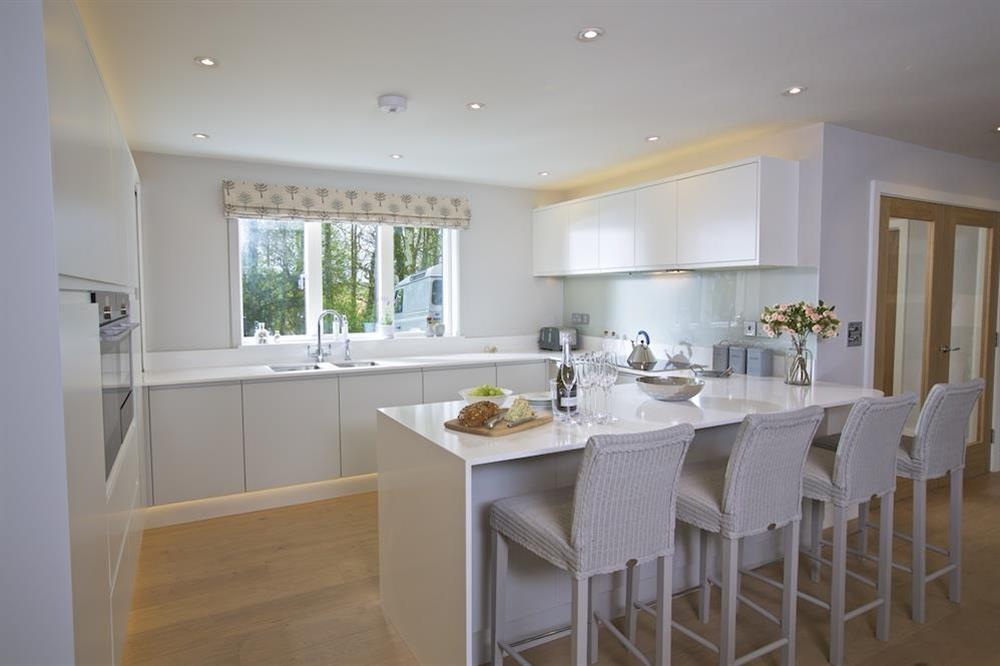 Elegantly designed kitchen with breakfast bar at 3 The Drive in , Hillfield, Dartmouth