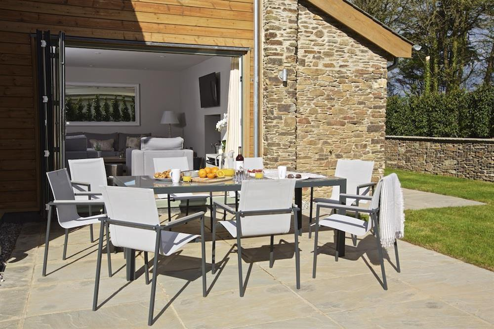 Good-sized stone terrace - furnished with a garden table and eight chairs (photo 2) at 3 The Drive in , Hillfield, Dartmouth