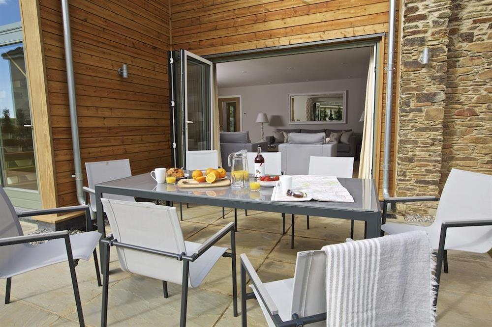 Good-sized stone terrace - furnished with a garden table and eight chairs (photo 3) at 3 The Drive in , Hillfield, Dartmouth