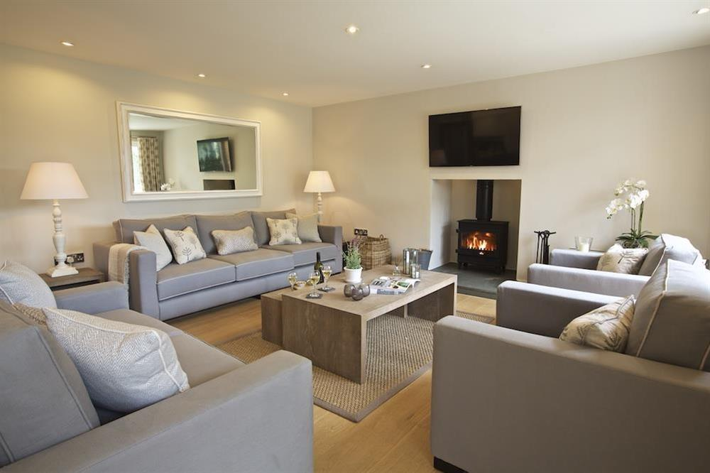 The sitting area to one end features a delightful wood-burning stove at 3 The Drive in , Hillfield, Dartmouth