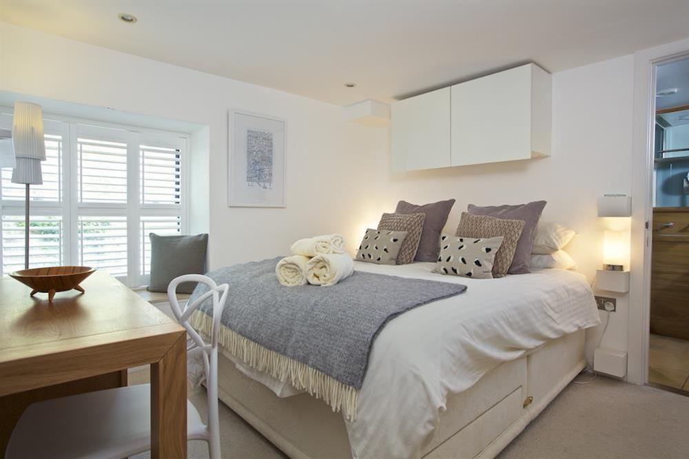 En suite master bedroom with King-size bed at 3 The Pottery in , Dartmouth