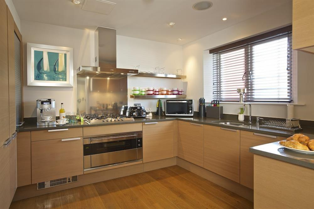 State-of-the art kitchen with stone worktops has lovely Poggenpohl units (photo 2) at 32 Dart Marina in Dart Marina, Dartmouth