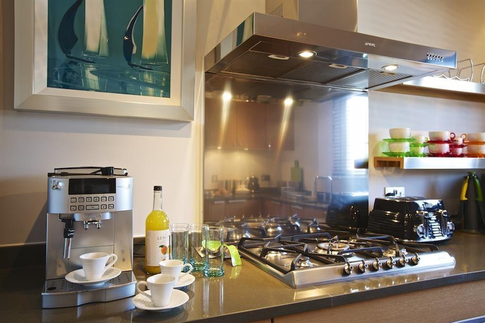 State-of-the art kitchen with stone worktops has lovely Poggenpohl units at 32 Dart Marina in Dart Marina, Dartmouth