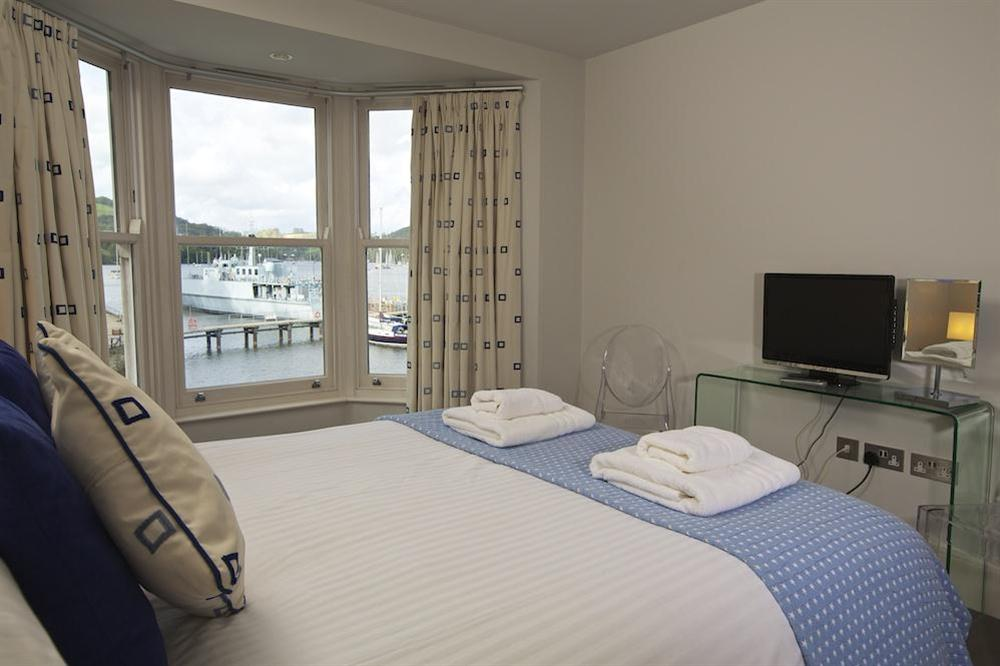 Master bedroom with lovely views up the River Dart and en suite bathroom (photo 2) at 35 Dart Marina in Sandquay Road, Dartmouth