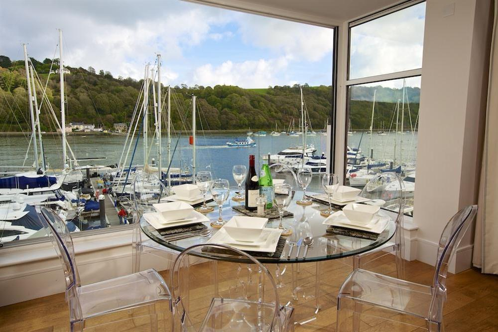 Round glass dining table and six chairs with stunning views at 35 Dart Marina in Sandquay Road, Dartmouth