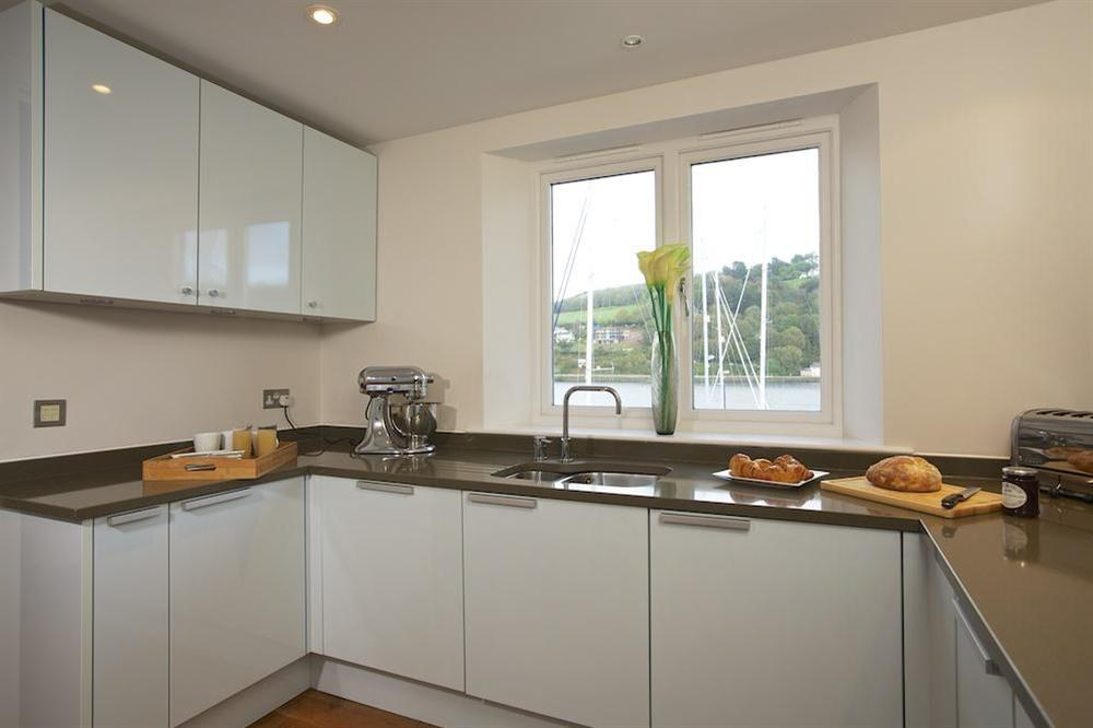 Stunning, state-of-the art kitchen with views over the River Dart at 35 Dart Marina in Sandquay Road, Dartmouth