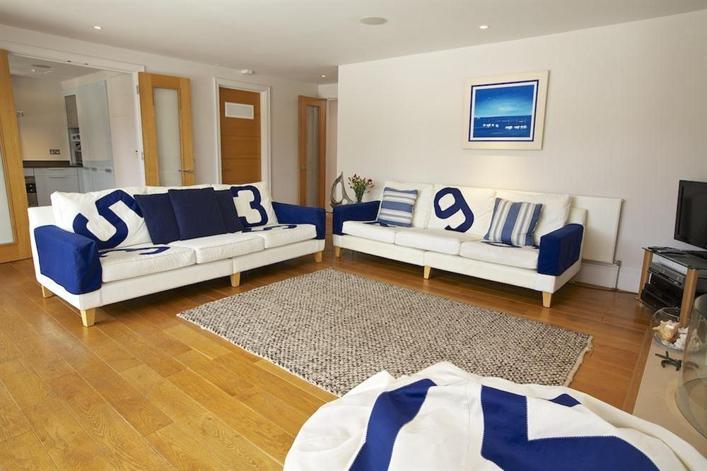 Stylishly elegant lounge leading to the kitchen at 35 Dart Marina in Sandquay Road, Dartmouth