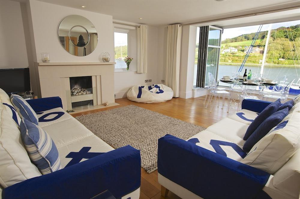 The stylishly elegant lounge with an internal balcony offering lovely views up and down the river at 35 Dart Marina in Sandquay Road, Dartmouth