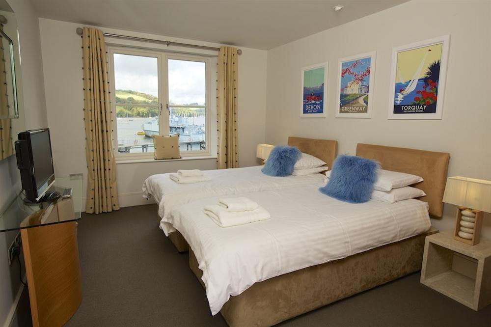 Twin bedroom (with Zip and Link beds) with stunning views towards Noss and Dittisham at 35 Dart Marina in Sandquay Road, Dartmouth