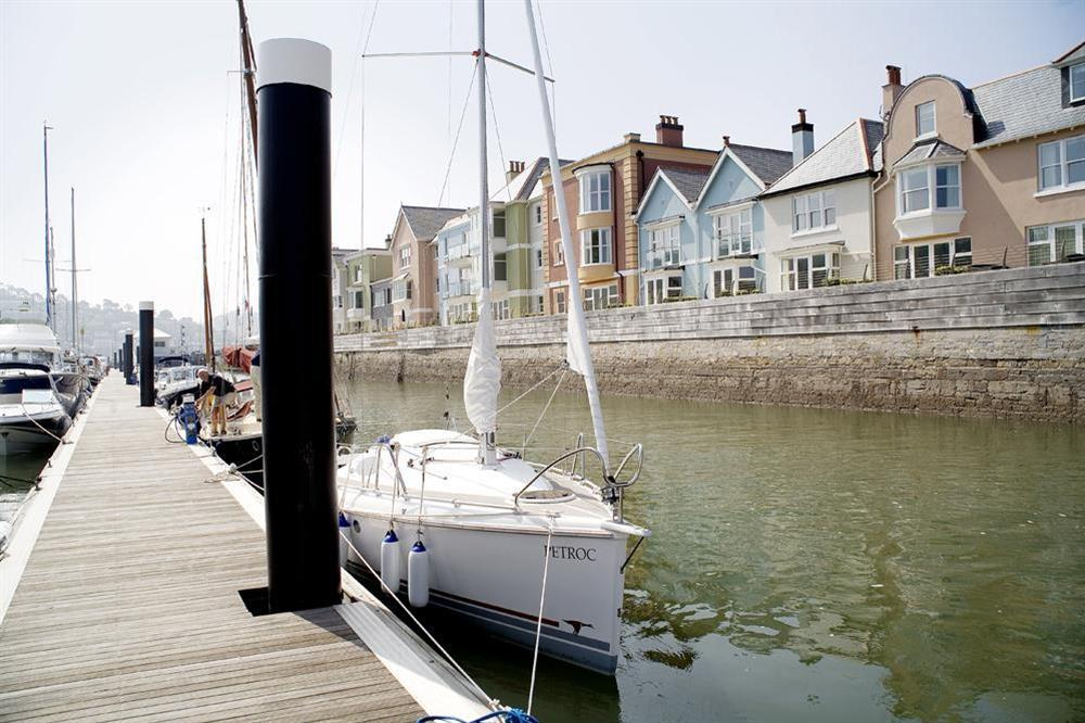 Dart Marina Apartments on the right with the marina on the River Dart at 36 Dart Marina in Sandquay Road, Dartmouth