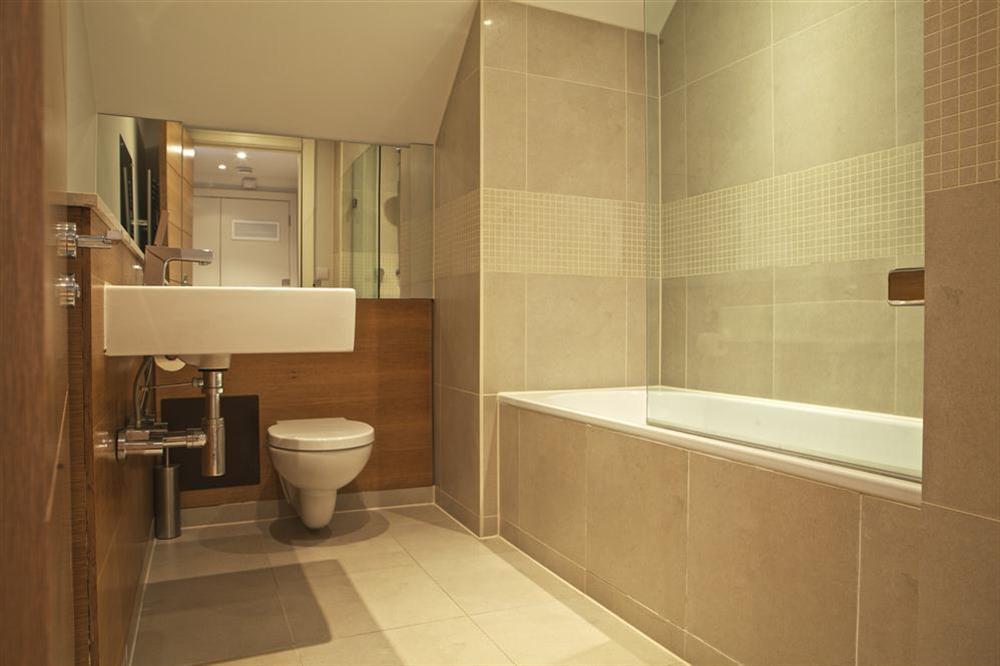 The beautiful bathroom has a Kadelwei bath (photo 2) at 36 Dart Marina in Sandquay Road, Dartmouth