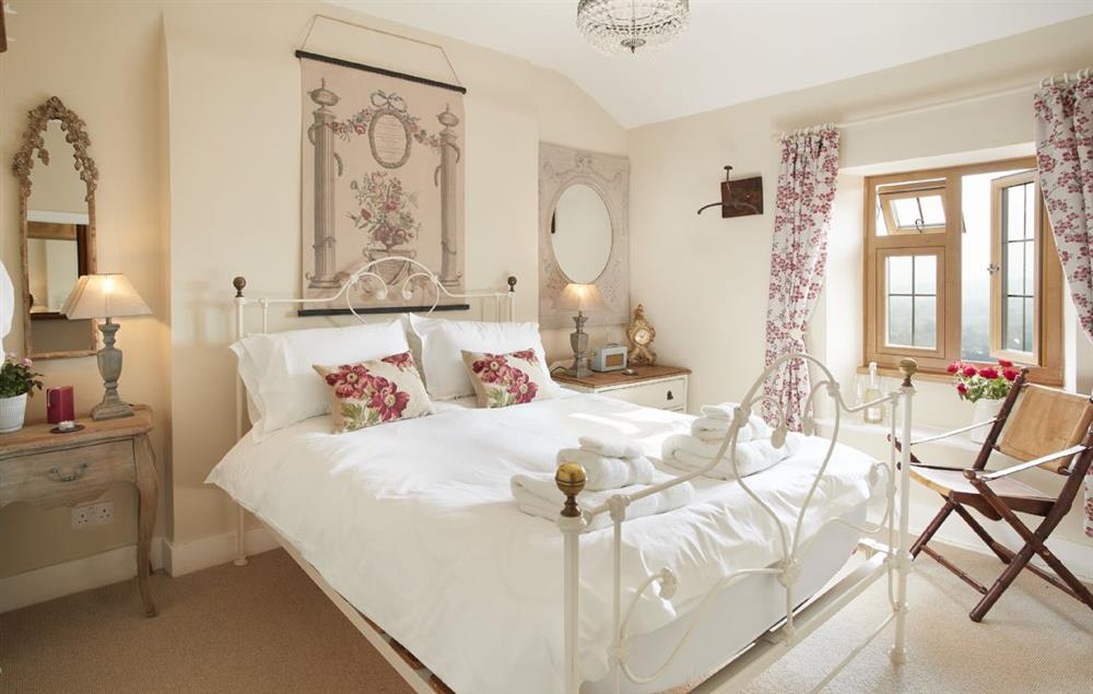 First floor:  The bedroom with a  king-size bed and rear views of the stunning countryside and deer park